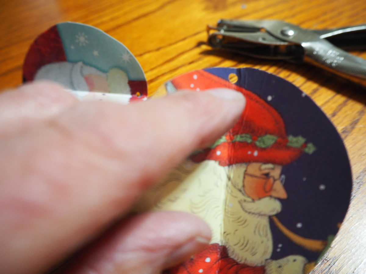 Use the paper punch to make a small hole in the top center of your ornament.
