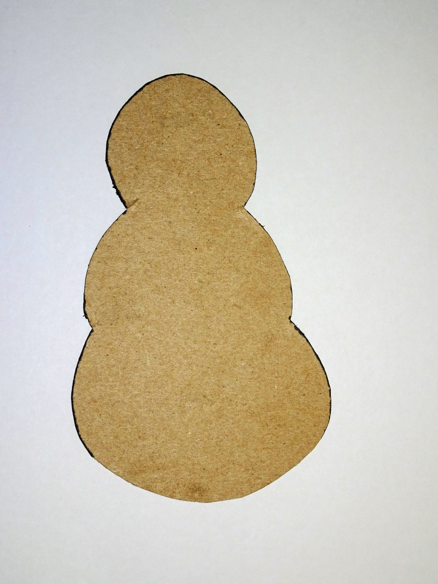 Cardboard template you can use to trace the snowman shape onto your bag.