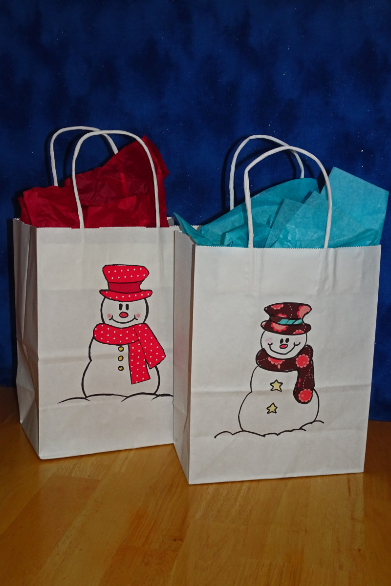 Two different snowman gift bags