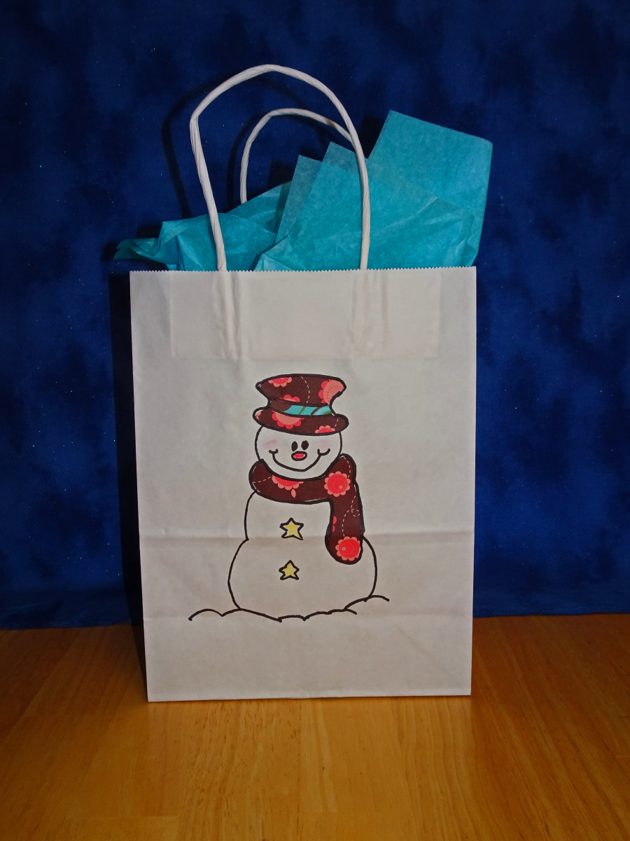The snowman bag, using paper scraps with a floral pattern