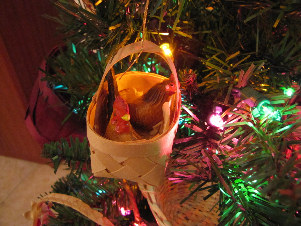 Two vintage hens in a small basket on the Christmas tree.