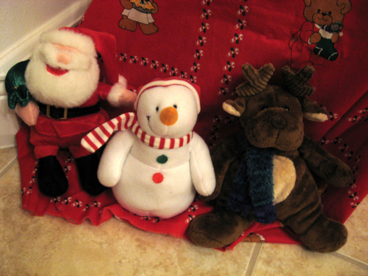Fabric covers the tree base and the box that it sits on. Then I surround it with stuffed animals.