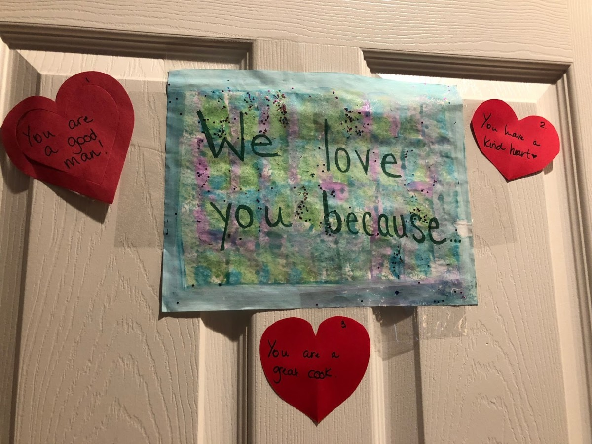 "This picture was from a year that the kids helped me make the hearts for their dad, so I included a ""We love you because"" sign in the middle."
