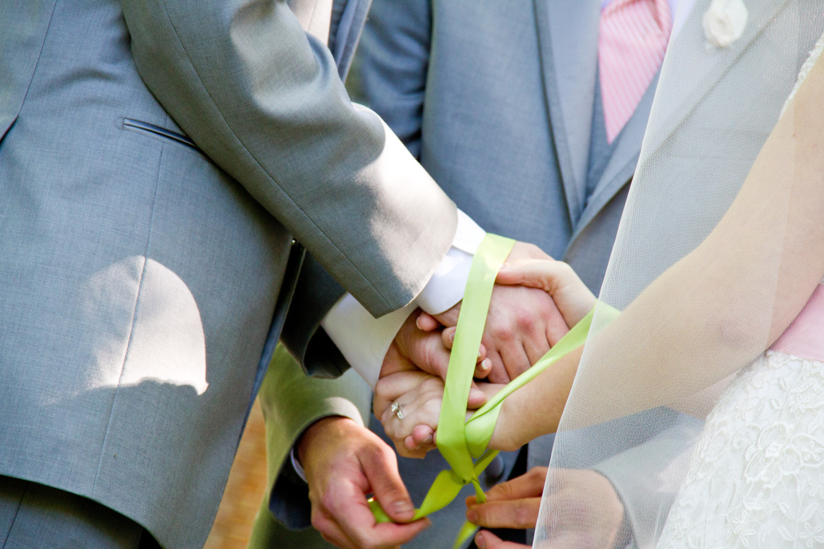 A ribbon is used to represent the binding of two individuals as one.
