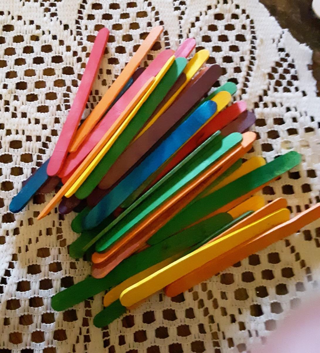 Lollipop sticks come painted or plain.