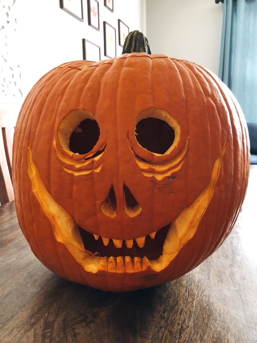 And this is my pumpkin after I carved it into a scary, goofy, grinning jack-o-lantern. Boo!