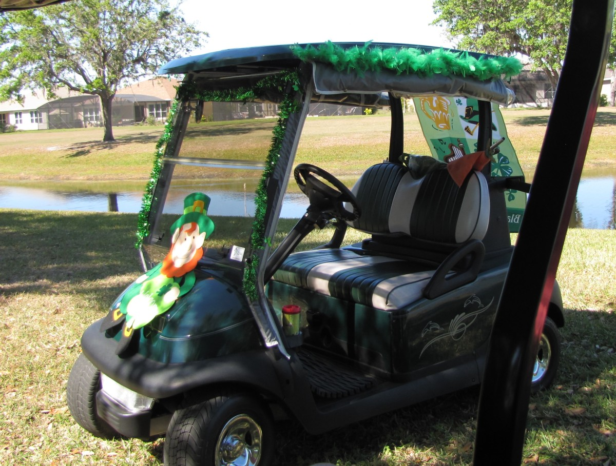 Shimmering green festoons the top of this cart and a rollicking leprechaun cavorts on the front. Make sure that you don't obstruct the driver's view. Safety first. A yard banner flutters from the back.