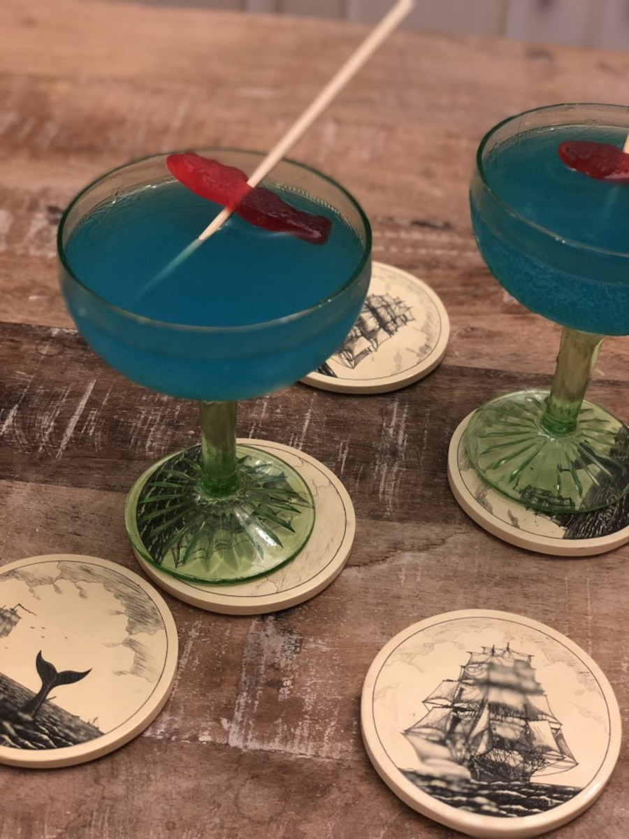 The Moby Drink made with vodka, Curacao, and Swedish Fish as a garnish