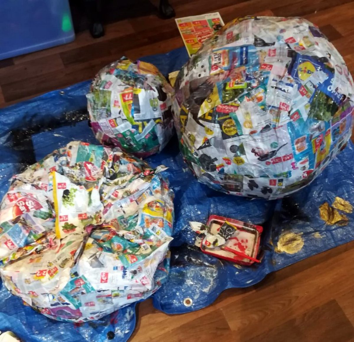 I use my homemade glue mixture to coat the inflated beachballs with newspaper. This process is very similar to paper maché.