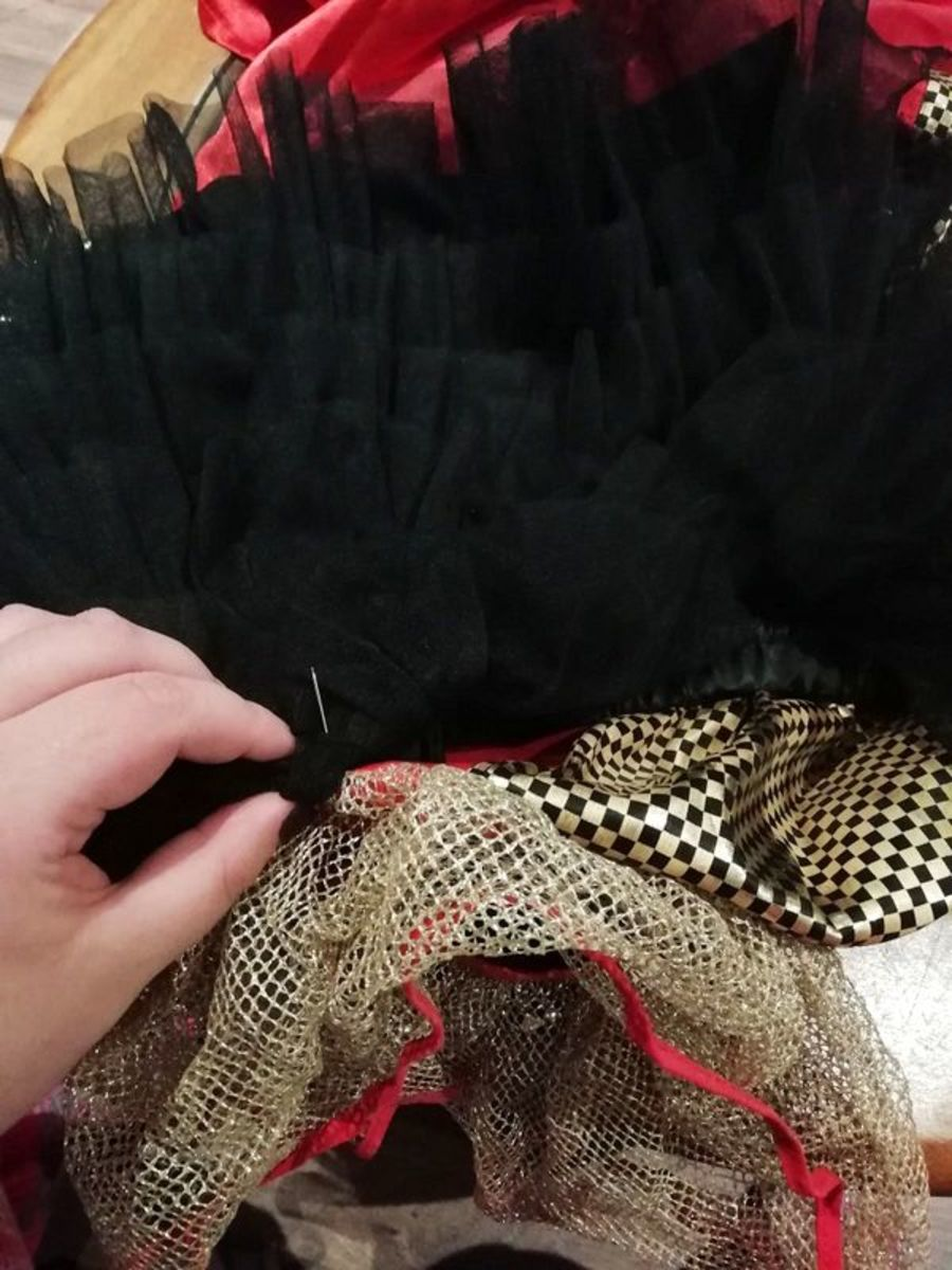 Sew the ruffles onto the clown costume