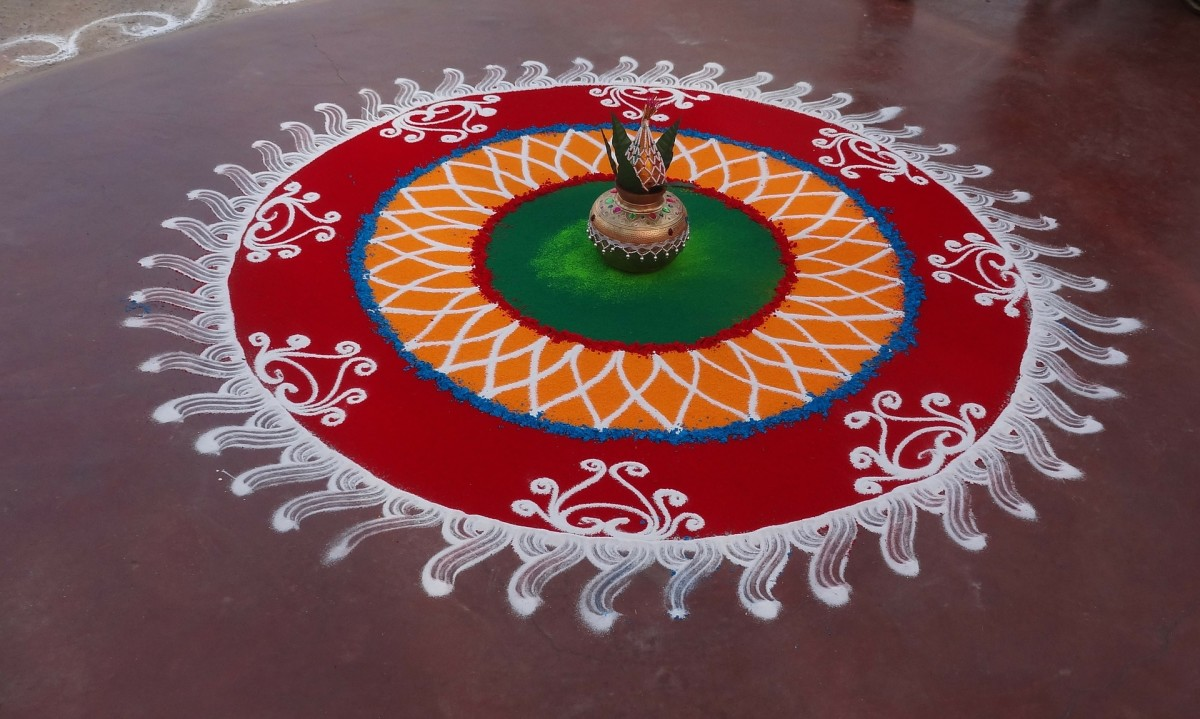 This is a good example of a medium-sized, symmetrical, circular rangoli.