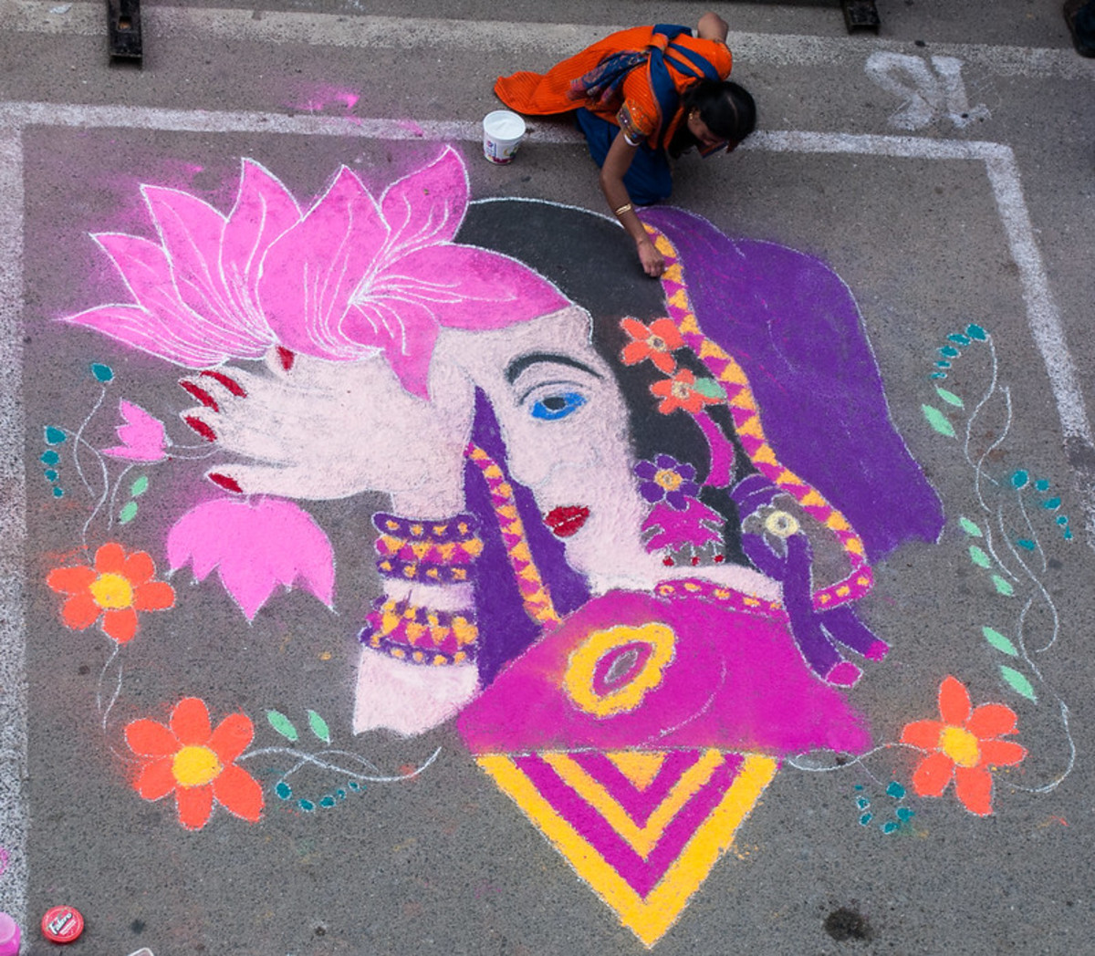 This ornamental (non-symmetrical) rangoli was created outdoors using chalk.