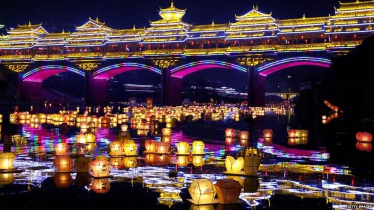 """In China, water lanterns which are lit up by worshippers and released in rivers, are believed to help hungry ghosts find their way home."" BBC News 2014"
