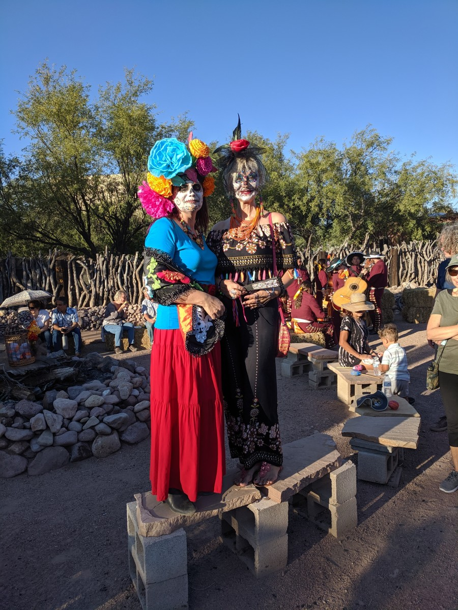 My wife posing with another woman in costume at end of the All Souls' Day Parade in Tubac, AZ