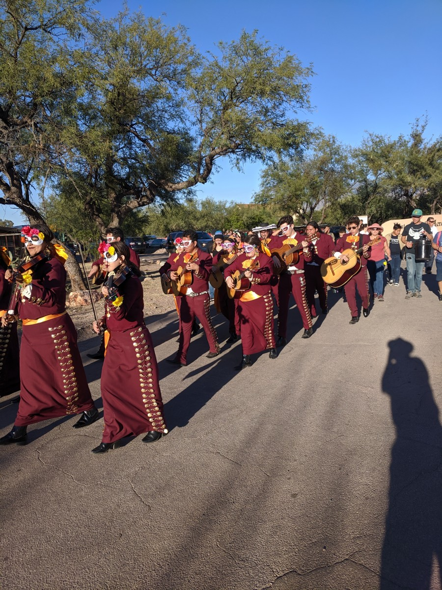 The Nogales High School band marching in the Tubac All Souls' Day/el Dia de los Muertos festival