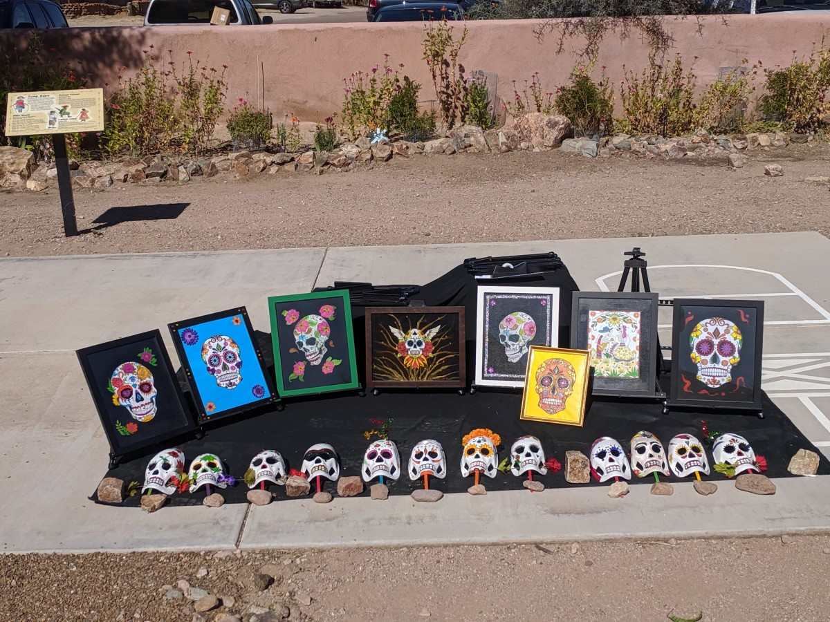 El Dia de Los Muertos masks and pictures on display in Presidio State Park in Tubac, AZ