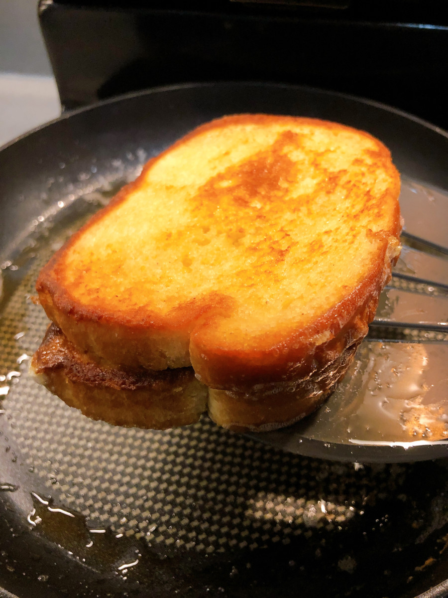 Once it's ready, pick the French toast up with a spatula.
