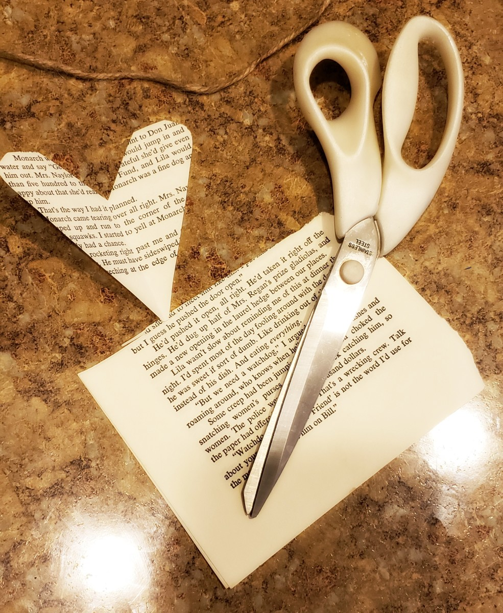 Cut heart shapes from your old book pages.