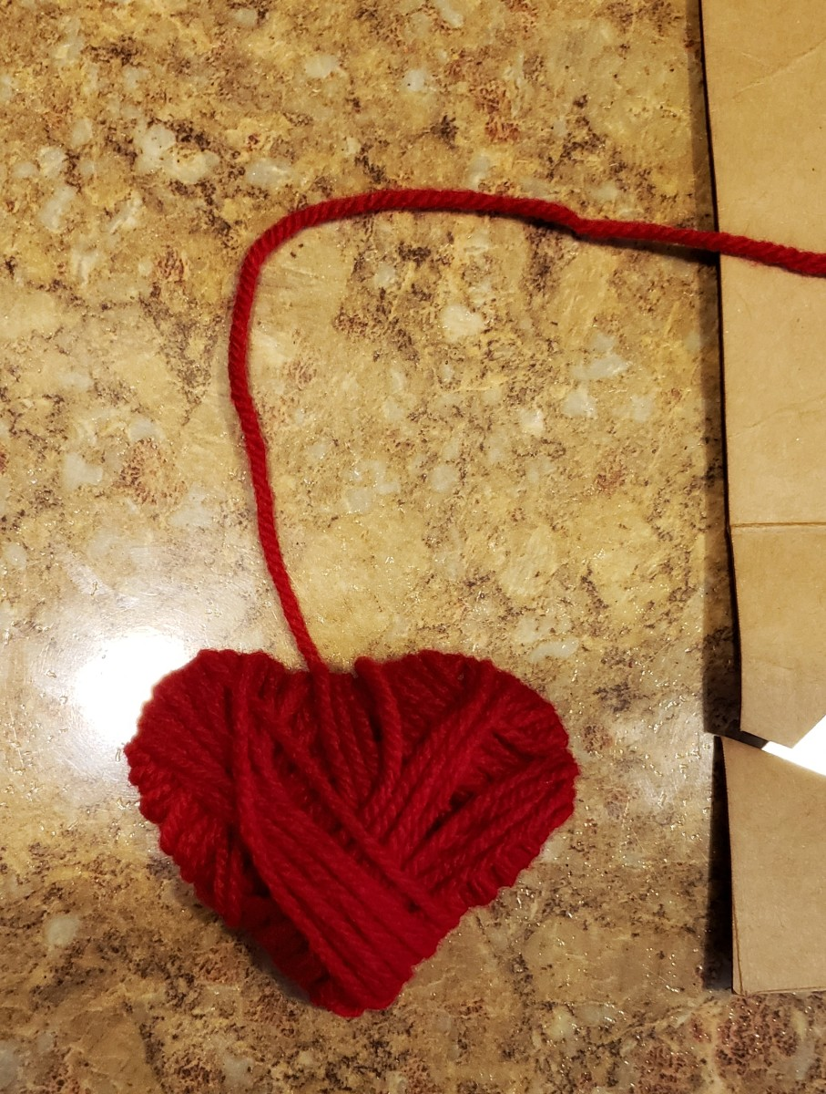 Cut the yarn, leaving enough to hang your heart up.