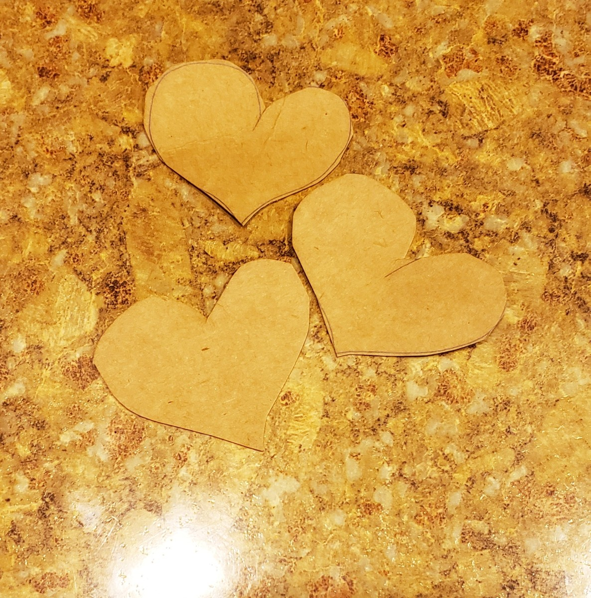 Cut out heart shapes from your cardboard.