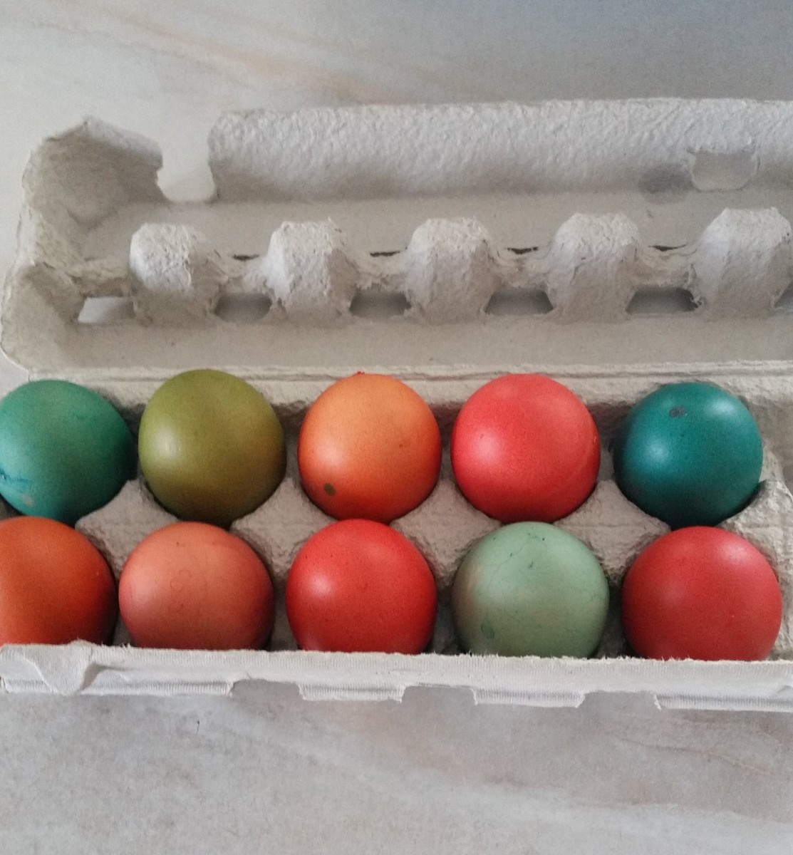 You're all done! A dozen vibrant, dyed eggs are ready for the Easter table.