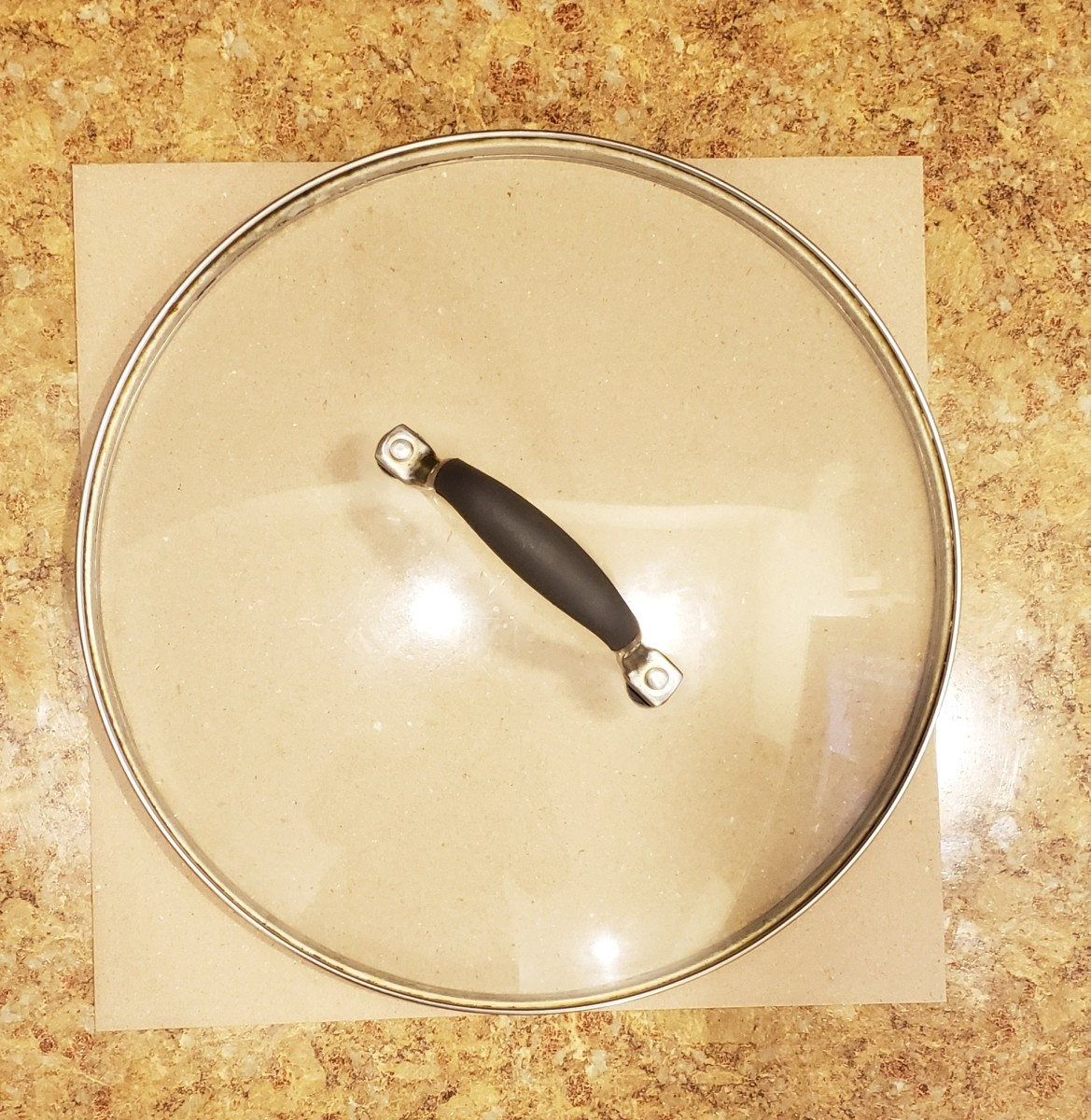 A frying pan lid makes a great guide for drawing a circle