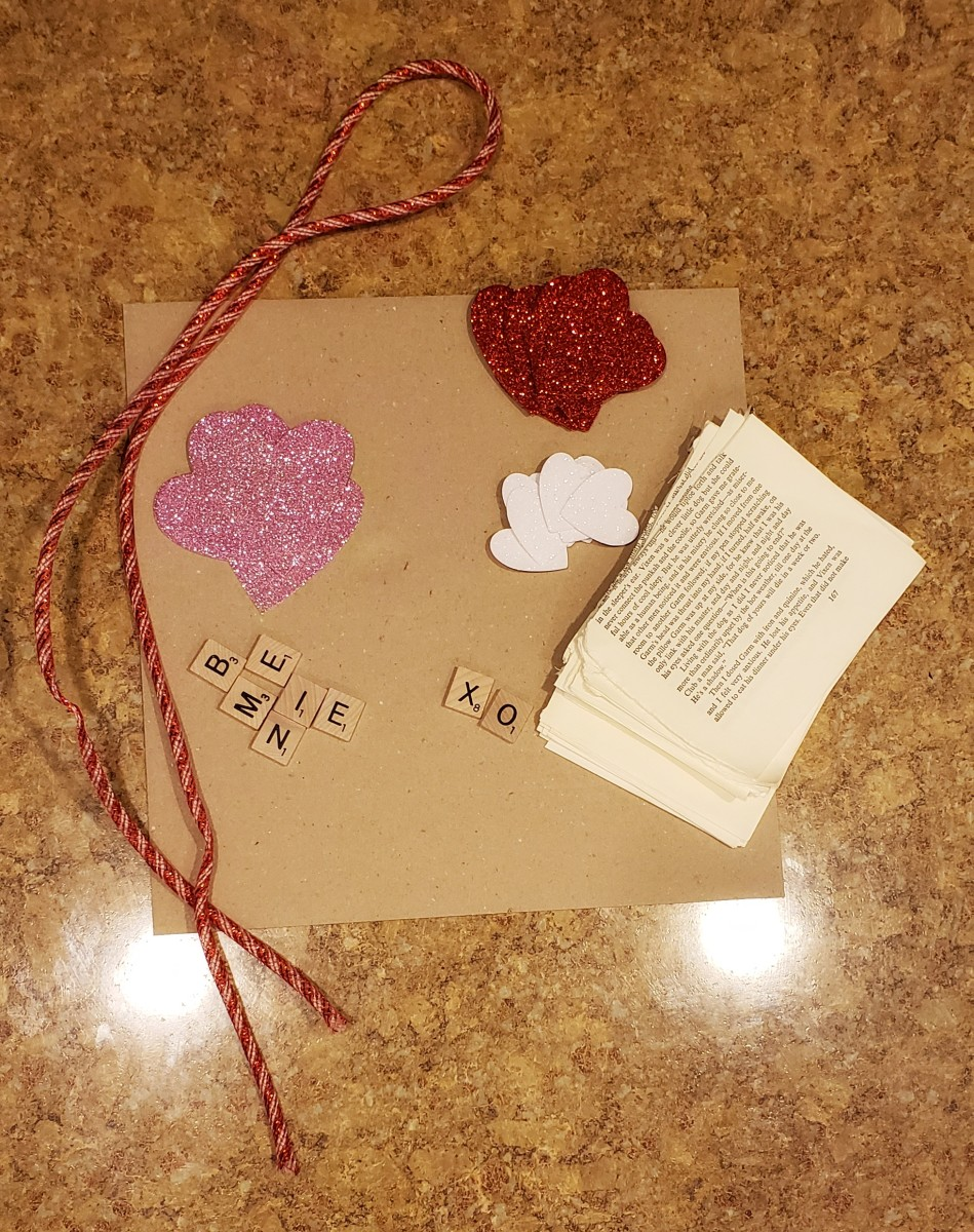 Materials needed for glitter and paper heart wreath
