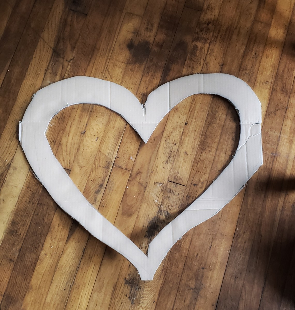 Cut out a smaller heart to create your cardboard heart wreath.