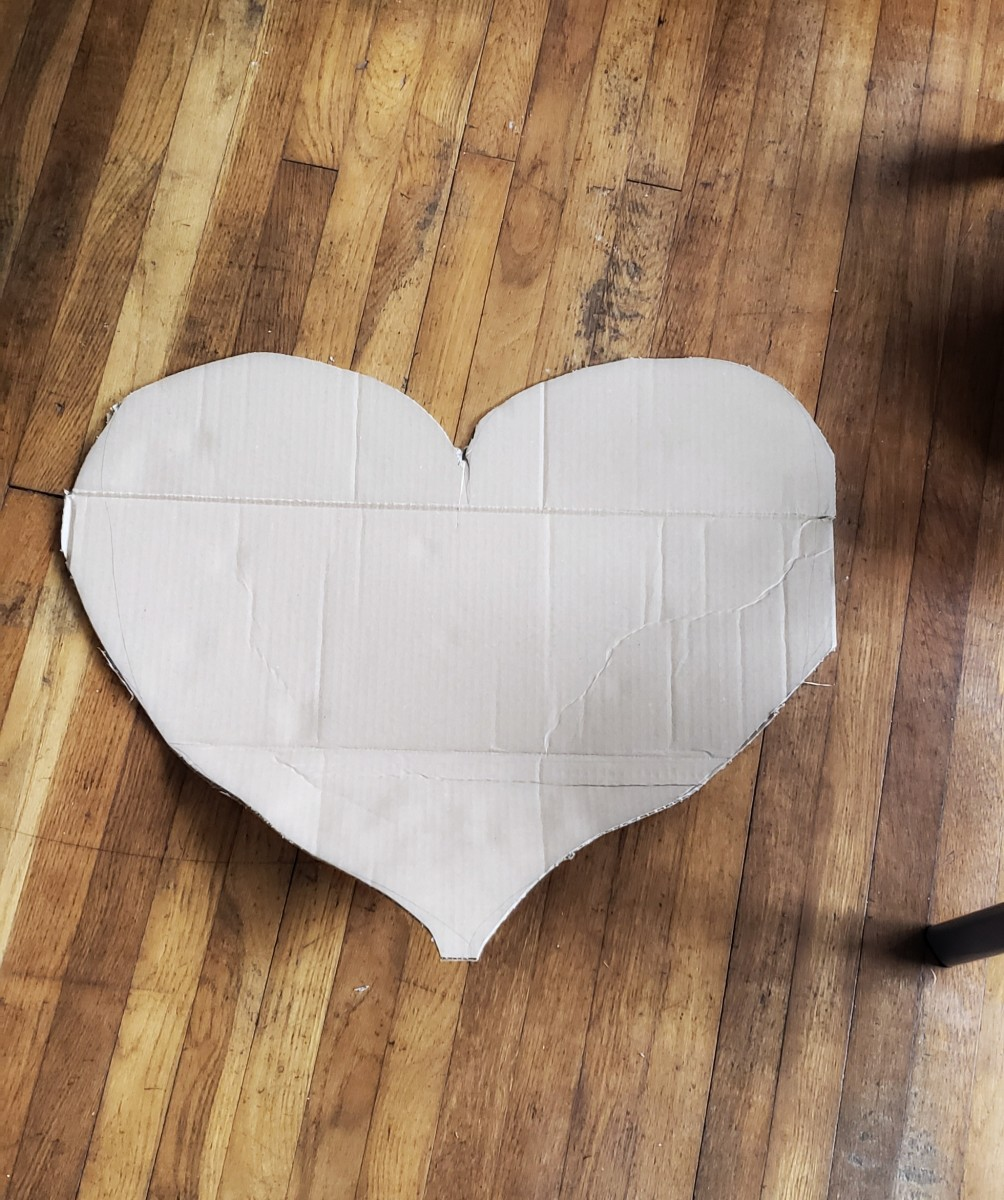 Cut a large heart out of your cardboard. It doesn't have to be perfect. The cards will cover up any straight lines.