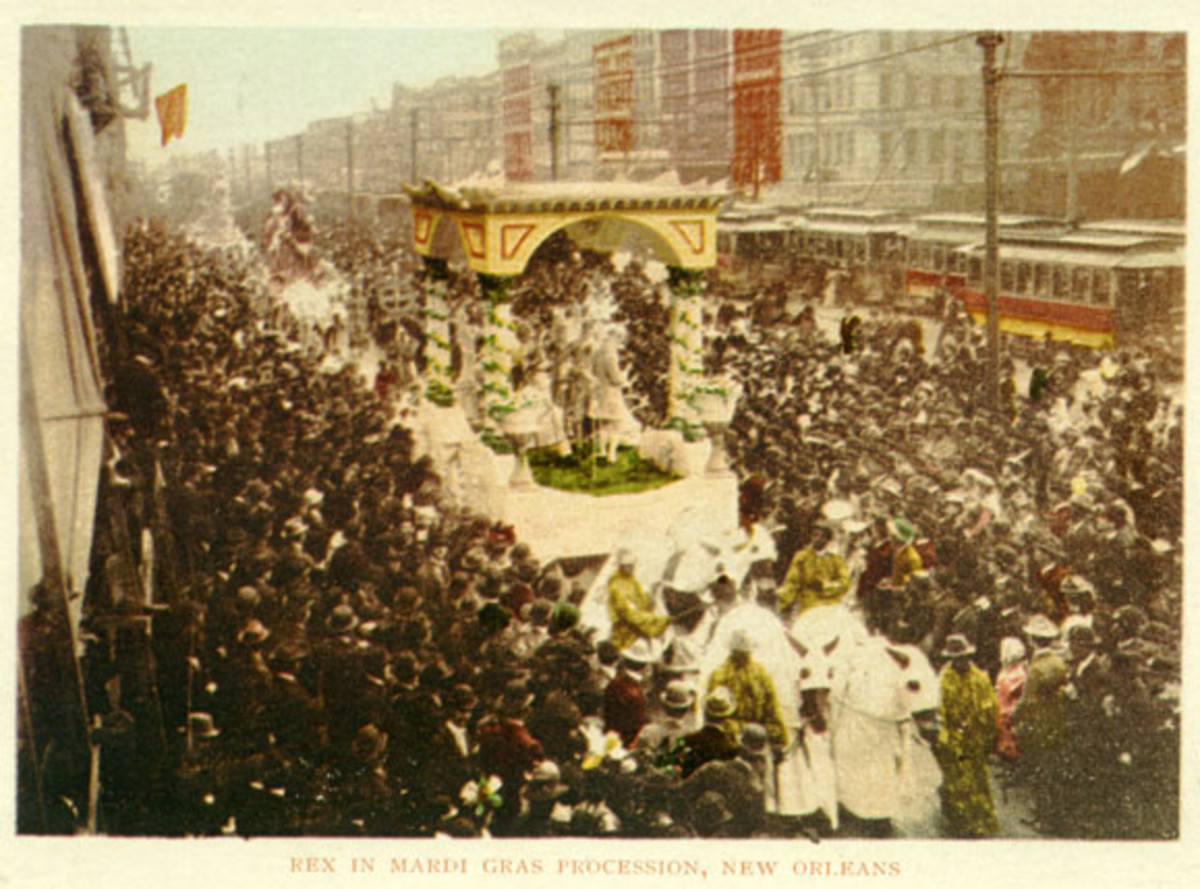This postcard view (approx. 1900) shows a horse-drawn Rex parade float moving down a crowded Canal street.