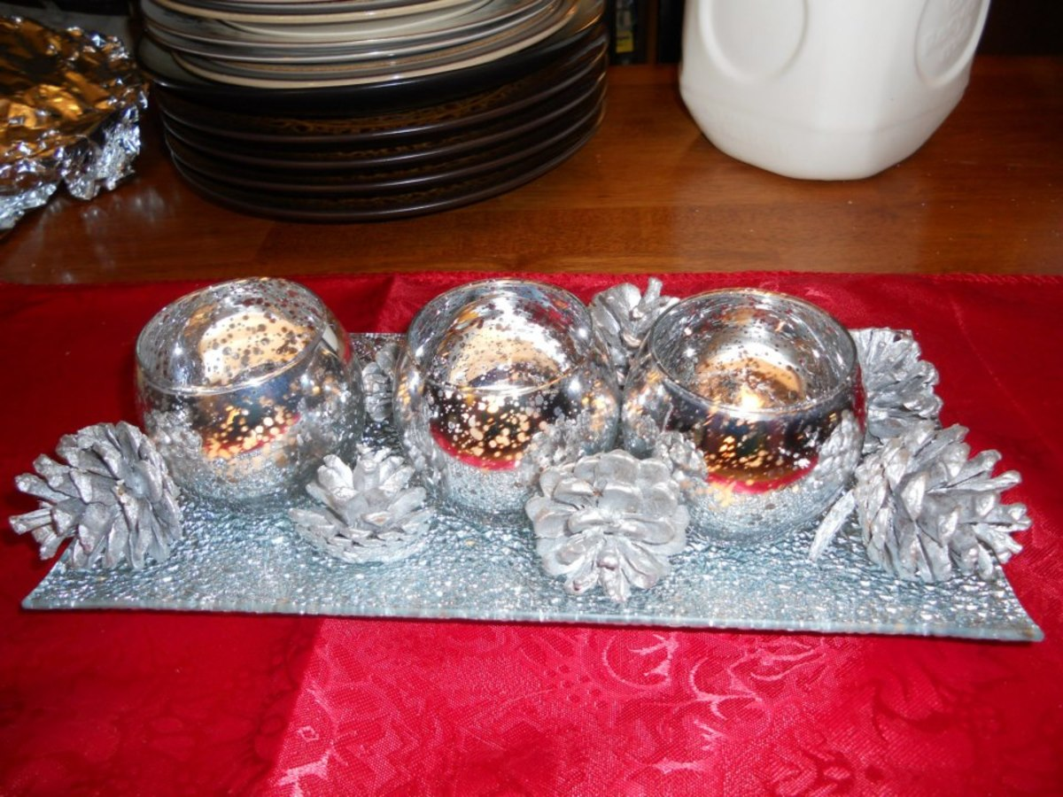 A silver tray, silver candle holders and groupings of pine cones spray painted silver makes a beautiful Christmas centerpiece.