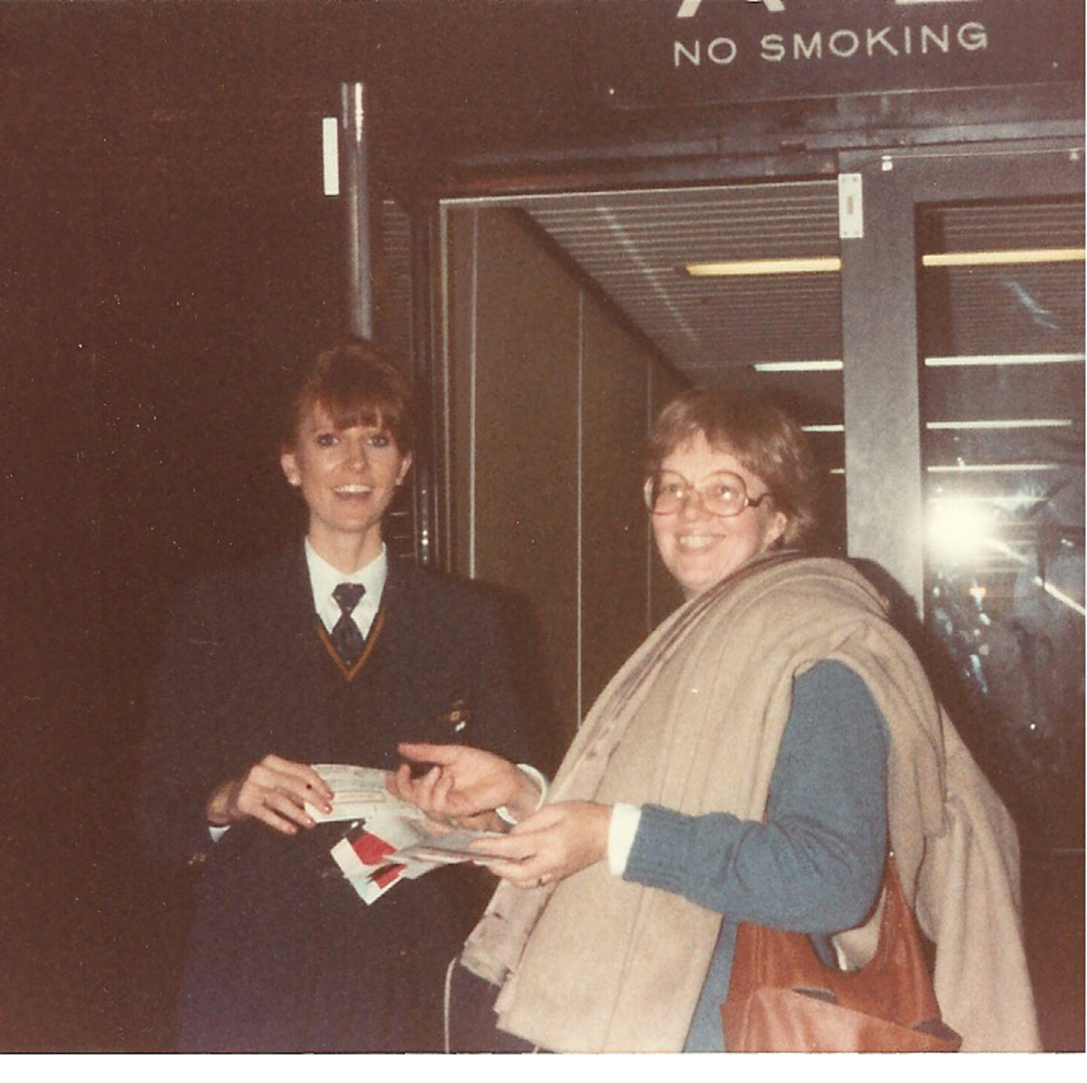 Here I am, boarding the plane to Australia. Note my sweater and heavy coat, which I would not need in sunny Australia.