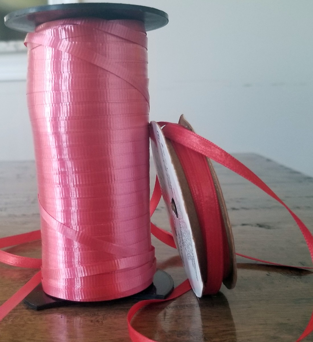 Red ribbon is attractive for commercial packages or personal gifts.