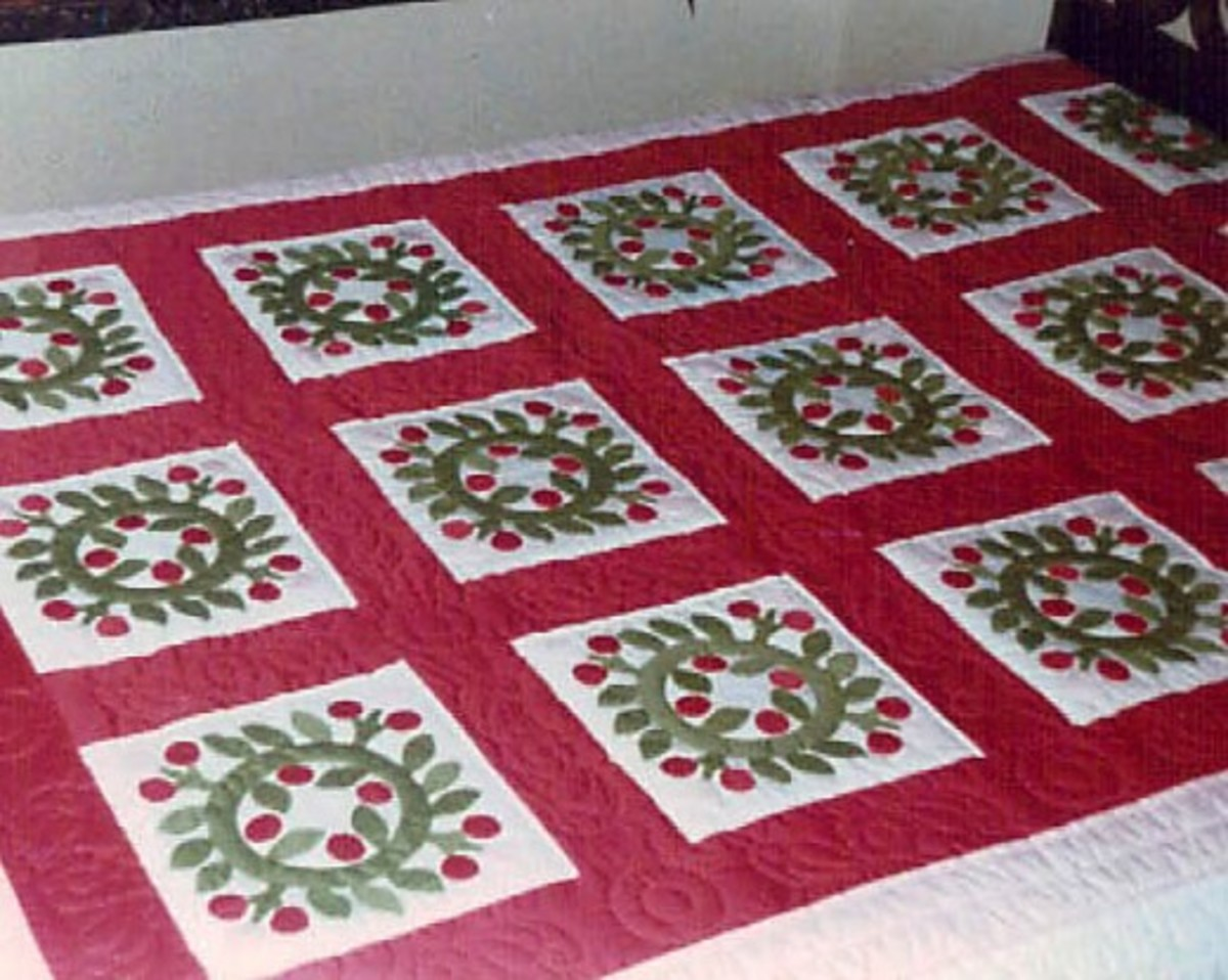 When I was president of the Baltimore Heritage Quilt Guild, they made this applique quilt to raffle off as a fundraiser. I love the designs and colors which are perfect to display at Christmas.