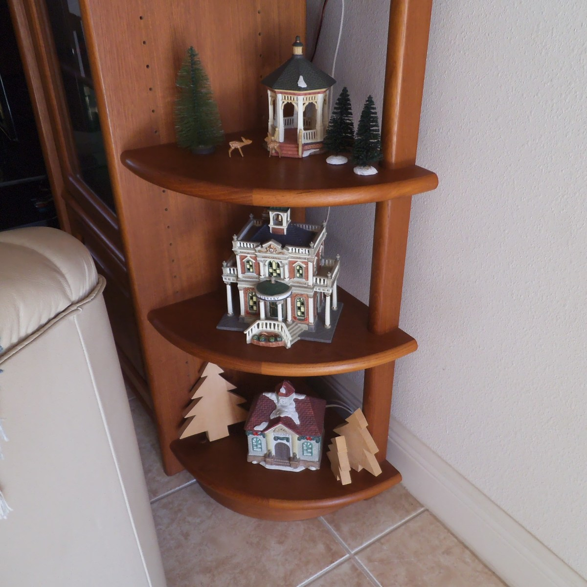 Some people set up a whole village scene with miniature houses at Christmas. I only have a few pieces so I display them this way.