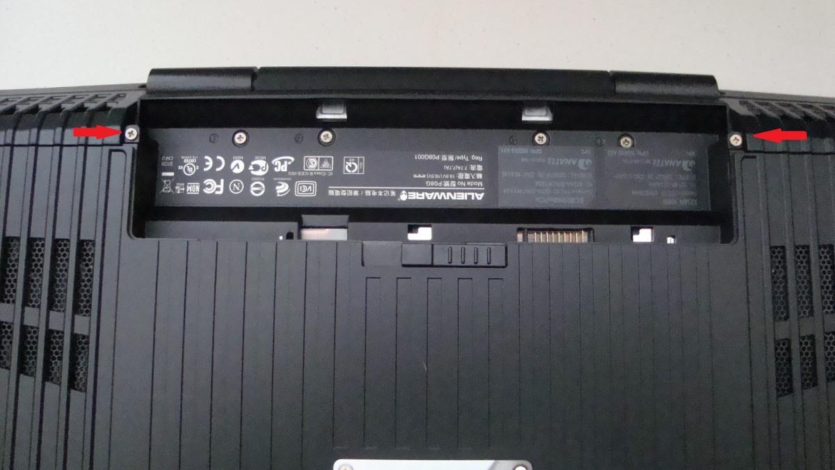 Remove the rear compartment screws