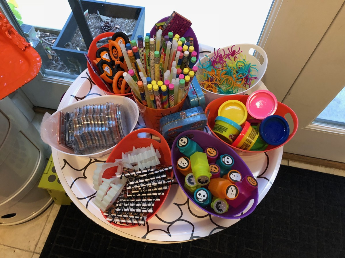 I offer a variety of non food treats and used to keep small containers of each. I had more hidden below a table and would replenish the bins after groups of children left. While visually appealing, it was challenging with large groups of kids.