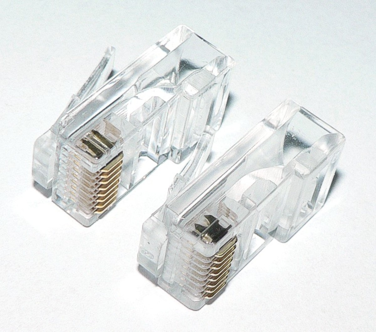 Two RJ45 connectors used with the UTP cable