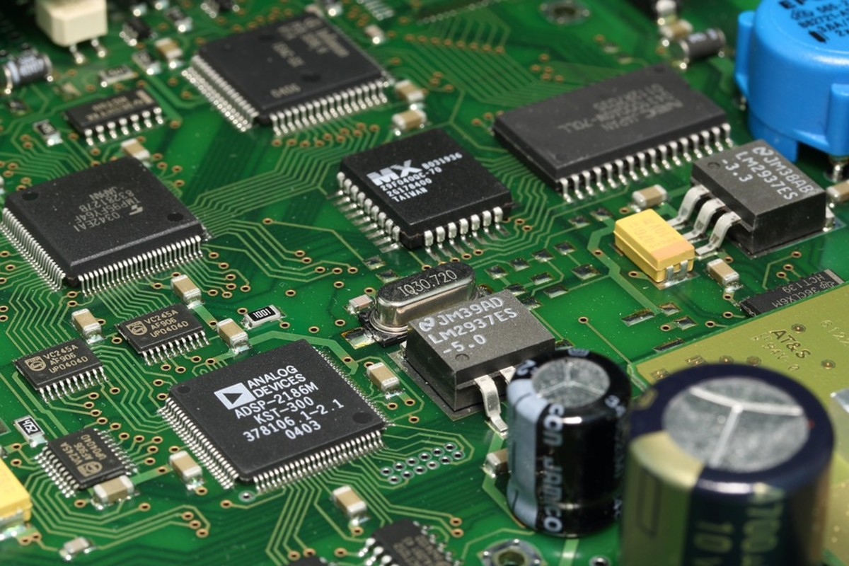 "A printed circuit board (PCB) with digital integrated circuits  (ICs or ""chips"")"