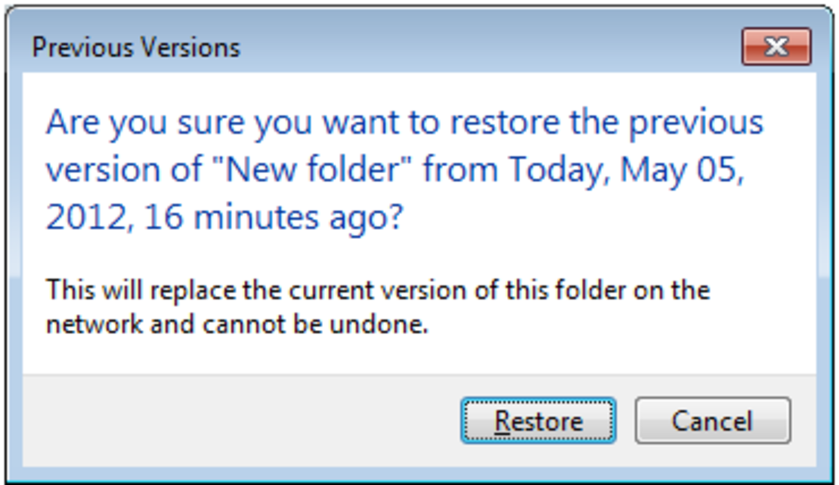 Warning received when restoring an entire folder from a Previous Version.