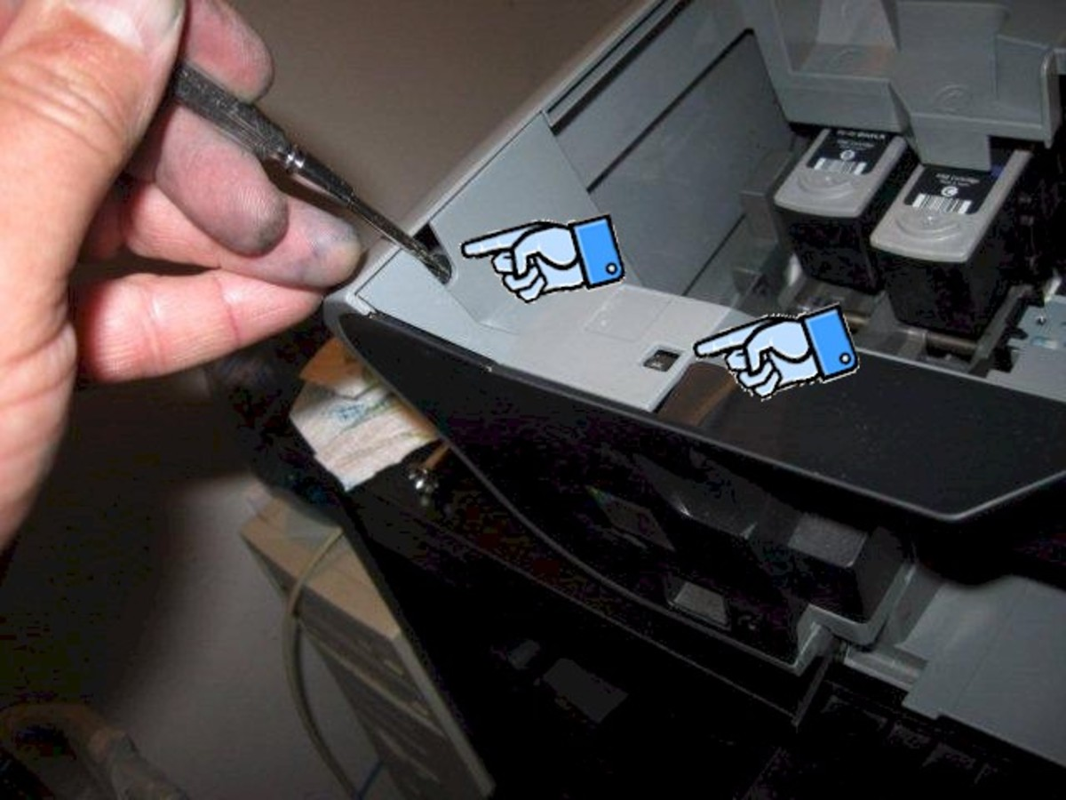 To remove the front panel, press a screwdriver into the clip slots on each side.