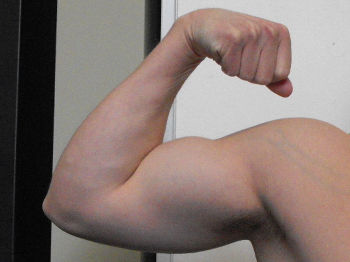 Flexing bicep muscle.