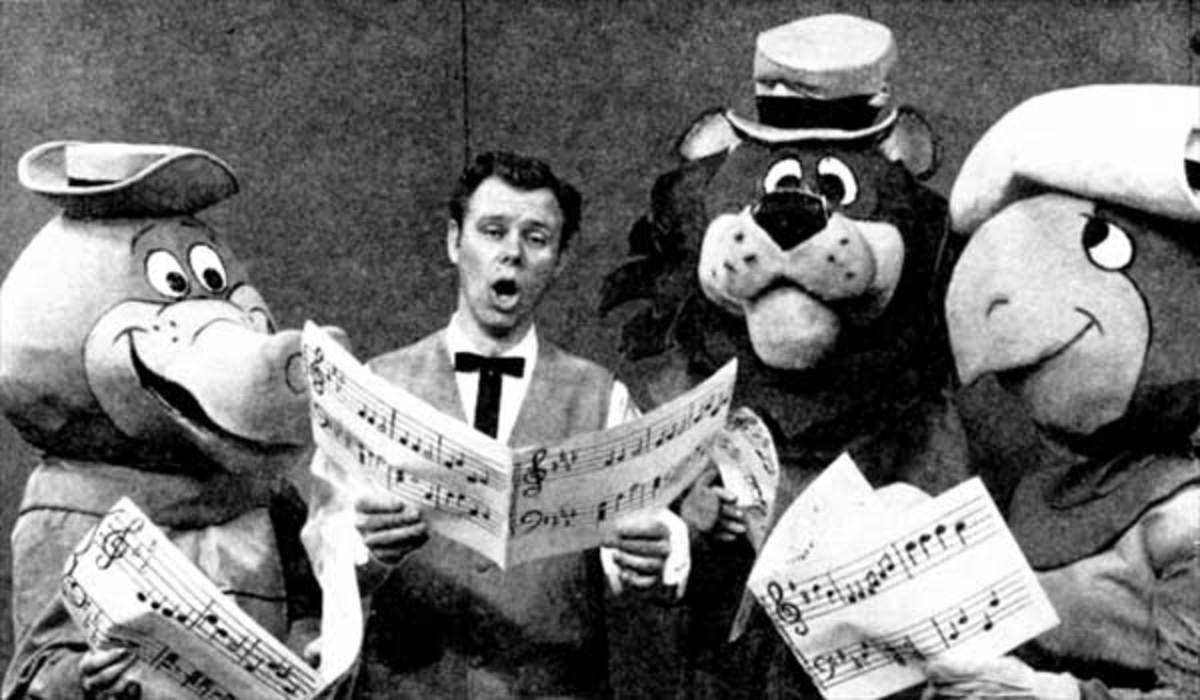 Wally Gator, Lippy the Lion, and Touche Turtle gathered around Portland television entertainer Ramblin' Rod Anders
