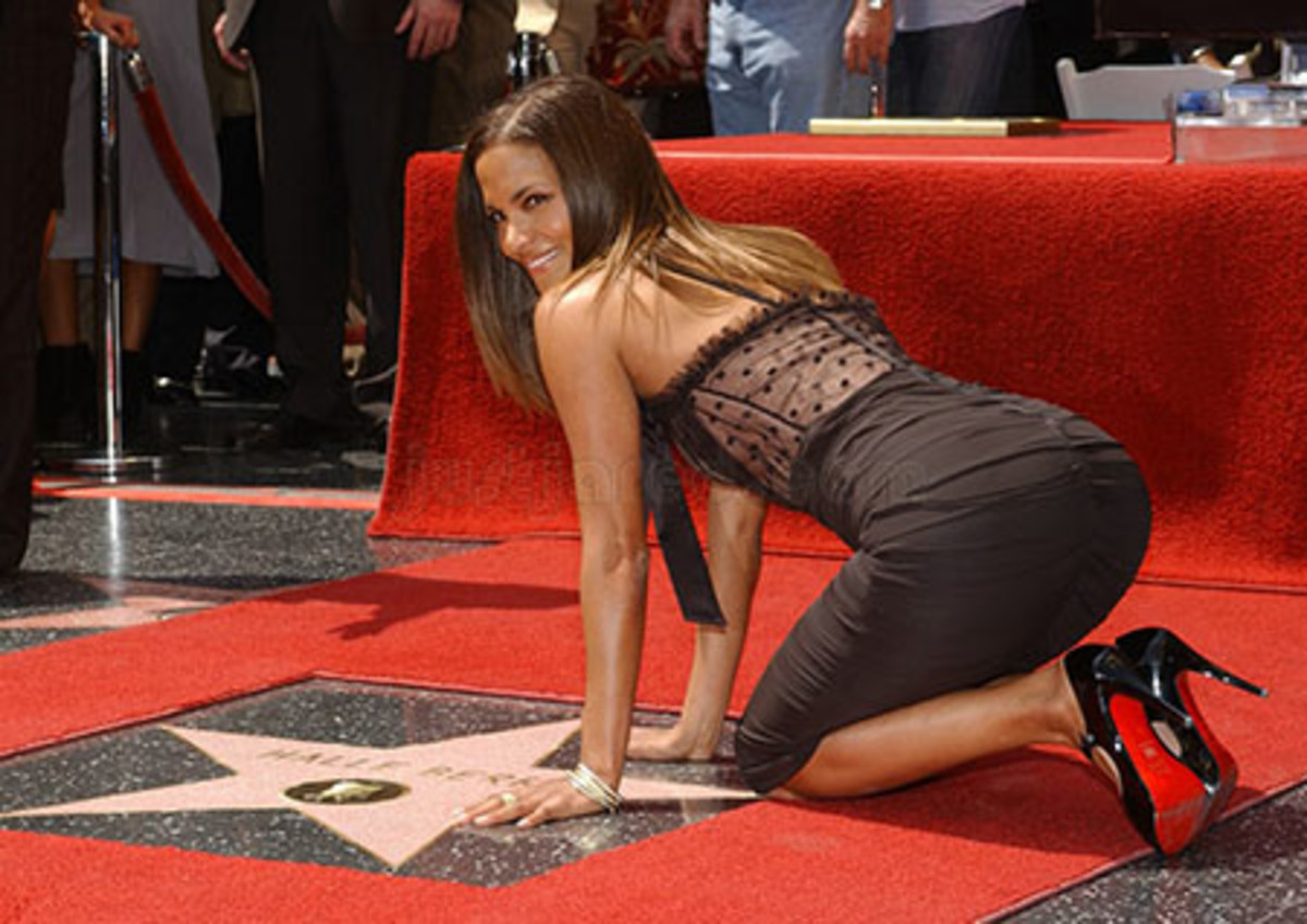 Halle Berry poses on her Hollywood Blvd Walk of Fame Star on April 3, 2007.