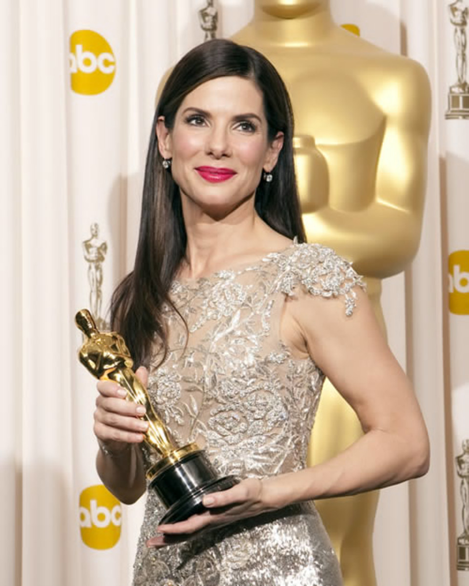 Bullock's good luck charm, her Marchesa gown was inspired by the Oscar statue itself.