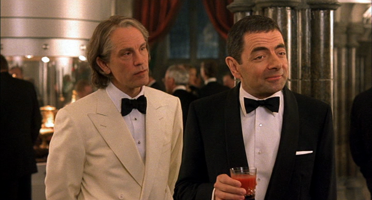 Malkovich (left) excels as the film's baddie, hamming it up in a rare comedic role.