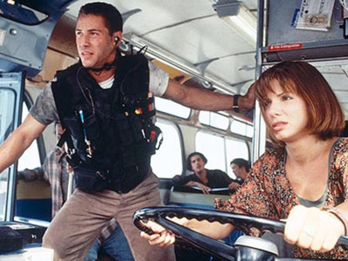 Reeves (left) and Bullock form a believable pairing in the face of the film's chaos...