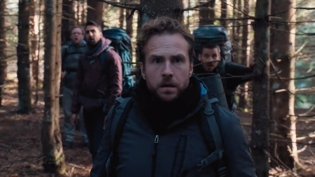 Rafe Spall as Luke, leads the group through the forest in 'The Ritual' (2018), a Netflix Original.