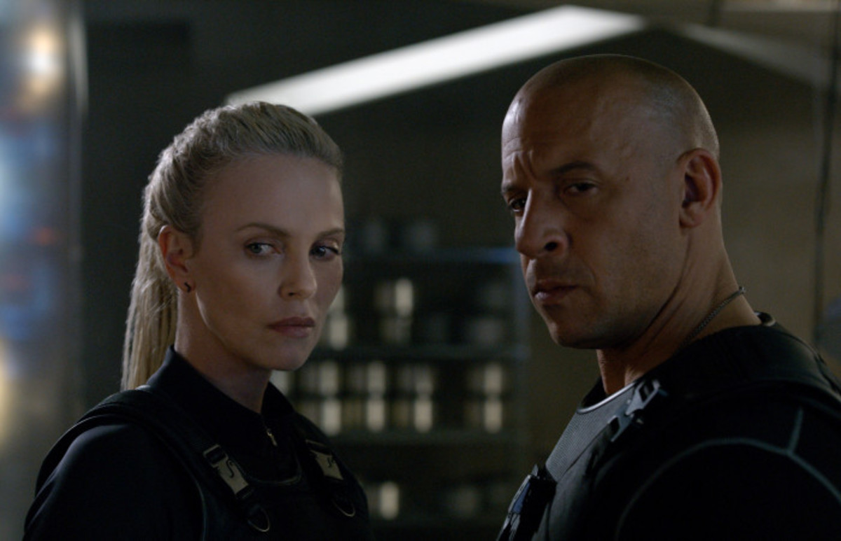 Theron (left) is an intriguing addition to the cast but her motives and ultimate goal remain elusive, undermining her baddie credentials.