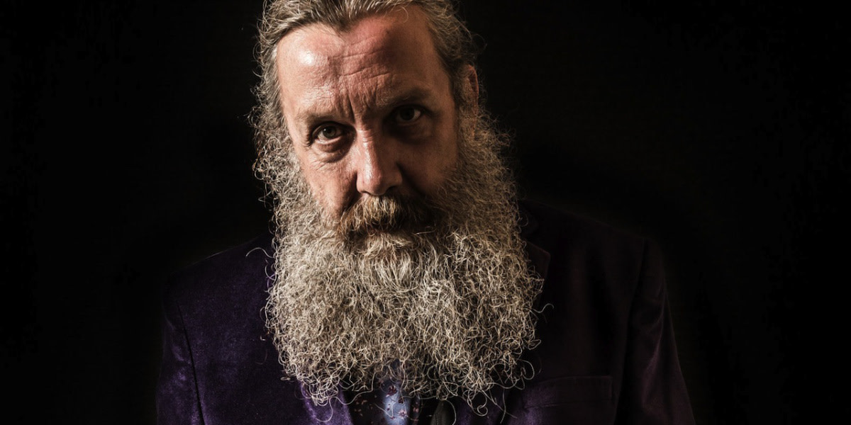 "Author Alan Moore refuses to be credited for movie adaptations of his work but his influence is everywhere in ""Watchmen""."